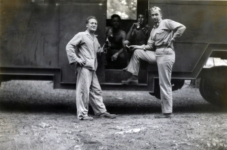 Four unidentified Marines relaxing in the trailer near the cookout site. The lieutenant at right wears a Fleet Marine Force Pacific Supply patch instead of a divisional emblem.
