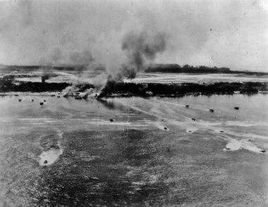Waves of marines are landed by LVTs with their objective - an airfield - clearly in view.