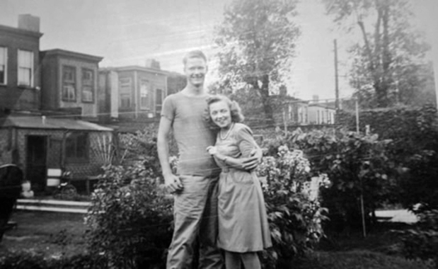 "Charles ""Cease"" Stafford after recovering from an unusual surgical procedure that saved his arm after being shot on Saipan. He is posing here with his gunner's girlfriend, Doris - who would become Mrs. George Smith after the war."