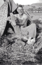 """""""A true infantryman. Feet feell just about this big and important after 30 miles in 6 1/2 hours. Although strangely I've never had a bit of trouble with them."""" [Photo shows Howie Haff, mortar section]"""