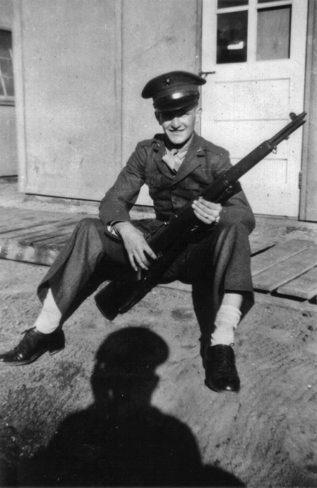 JJ Franey outside Hut 10, 1942. The bulge in his socks is a pack of cigarettes; Marines often stored valuables in their socks as dress trouser pockets were difficult to access.