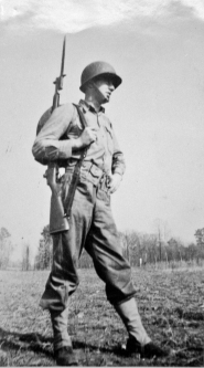 George Smith in full field gear with bayonet. 1942.