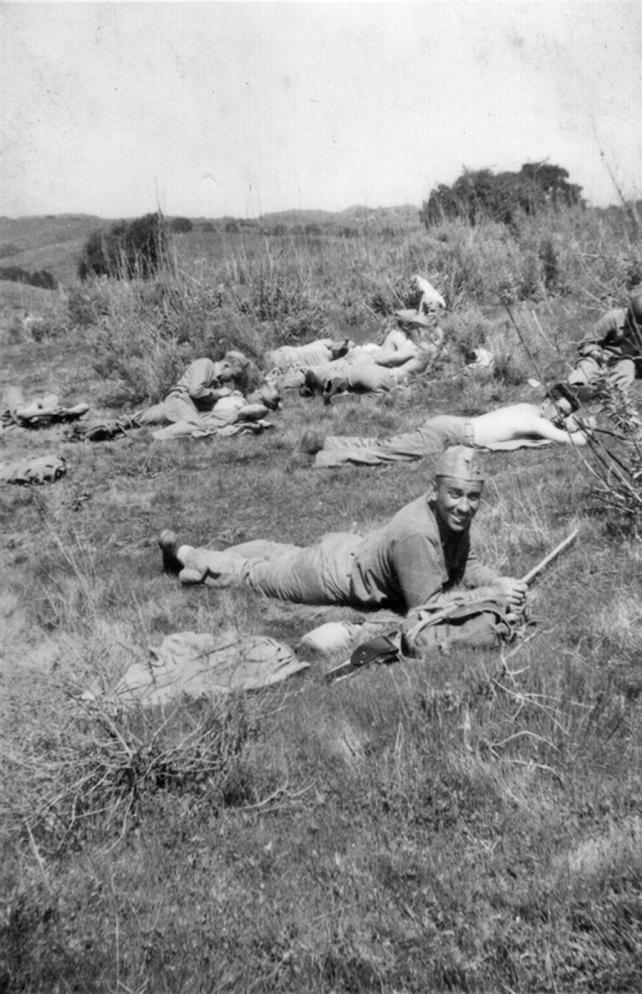 "Gunny Russell during a field exercise. Russell was known for being ""squared away"" at all times, as evidenced by the perfect placement of his garrison cap even during a rest break. Camp Pendleton, 1943."