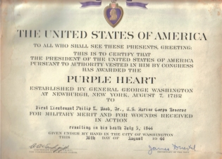 This certificate was sent with Phil's Purple Heart medal.