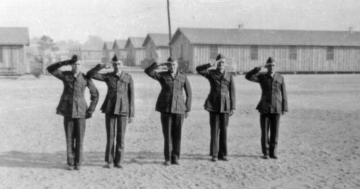 "Snap a salute with a ""seabag crease"" in their trousers, these Marines report for KP following their trip to the rifle range."