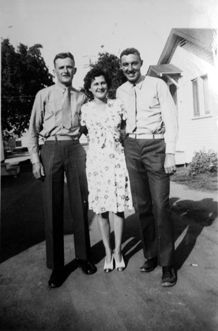 Machine gunner Tom Hurley was a married man. His wife, Anne, followed the company as they traveled across the country, and set up a home in a rental house in Oceanside, California. JJ Franey and George Smith pose with Mrs. Hurley.