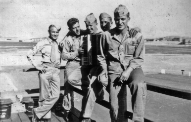 """Unknown 'swab jockey,' Hall, Fritz, Palmer, Spohn."" 1943. The corpsman is probably PhM3c Charles Hearn."