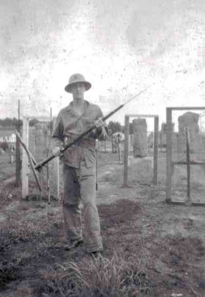 PFC Wood on the bayonet course at Quantico, 1942. He is carrying the 1903 Springfield rifle, standard issue for Marines in training and in combat during the early phases of the war.