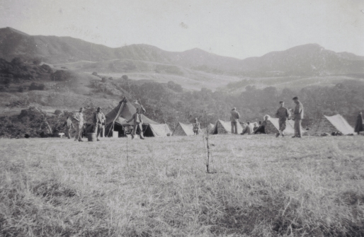 """""""Semaphore practice in front of the Company tent. Good shot of the California hills–a straight rise of 1000 feet or more, and all of our problems seem to takeplaceon top of these sons of guns. Certainly makes for beautiful scenery, though."""""""
