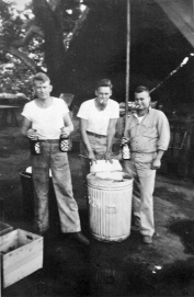 "James Coburn, Robert Williams, and John Yonkers ""€œgetting ready for the smoker."" Camp Pendleton, 1943."
