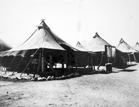 "The skipper's tent. Captain Irving Schechter worked out of this tent while at Camp Maui in the spring of 1944. The sign says ""C.O. CO A 1Bn 24th Mar."""