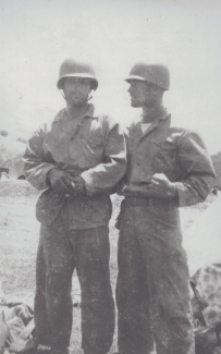 """""""Izzo getting the word from Corp. Shaw, squad leader mortars, a North Carolina boy bloodthirsty for Japs to avenge his brother on Guadalcanal."""""""