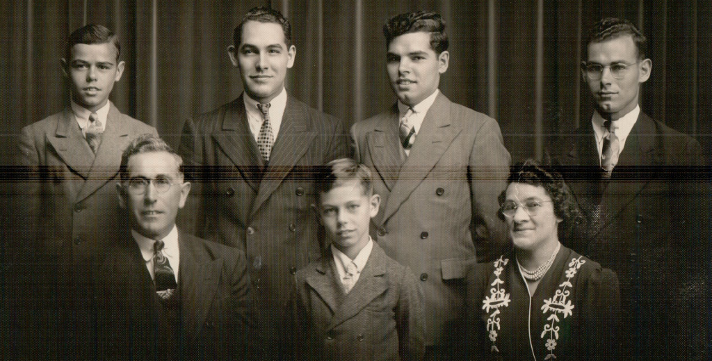 The Bolduc family before the war. Parents Euclide and Irene are on either side of youngest son Rene; the boys in the back, Joseph, Ernest, Lionel, and Marcel, all served in World War II. Photo uploaded to Ancestry.com by Richard Bolduc
