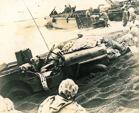 This photo of a disabled Jeep with a poncho-covered Marine casualty is from Lloyd Abbott's collection of wartime photos.