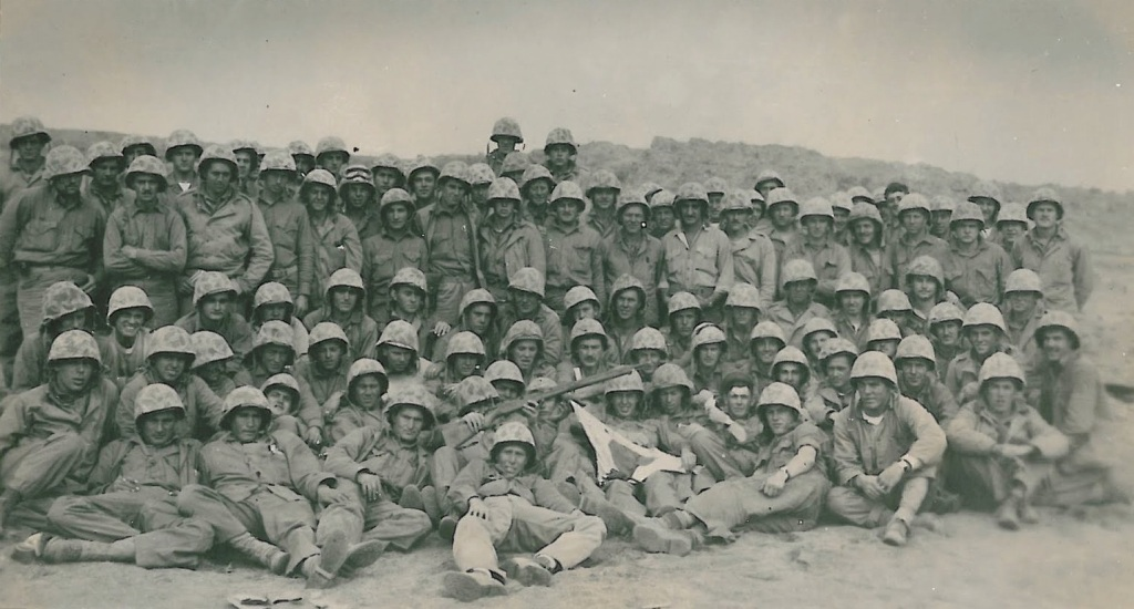 Abbott saved this picture of the survivors of Companies A and B after Iwo Jima. He is barely visible standing between & in front of the tall Marines in the last row.