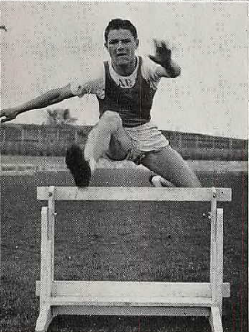 "Anderson ""demonstrates his low-hurdle form"" for the 1942 Blue & Gold yearbook"