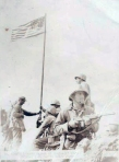 A professionally shot photo of the flag raising on Mount Suribachi.