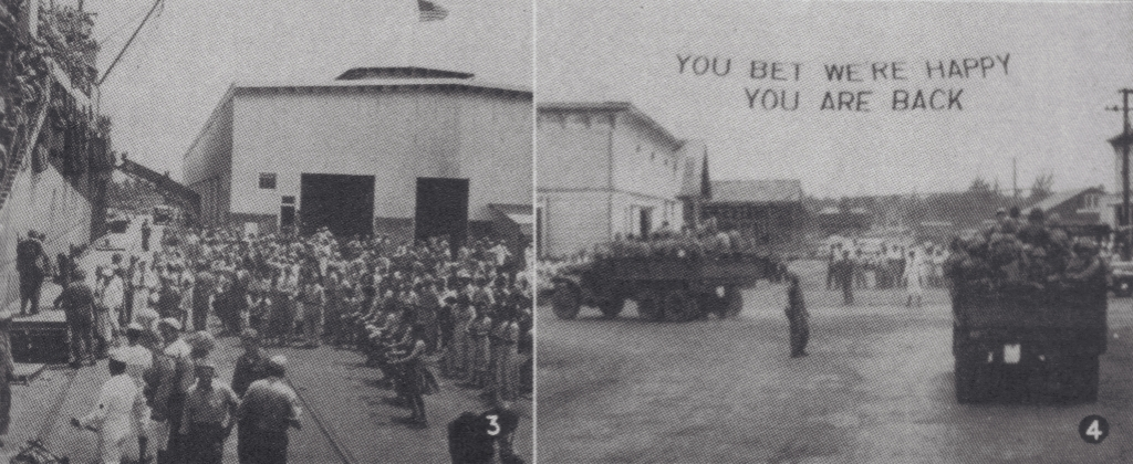 Marines disembarking from a transport at left are given a traditional Hawaiian greeting; the trucks passed under a celebratory sign as they drove to Camp Maui. April 4, 1945.