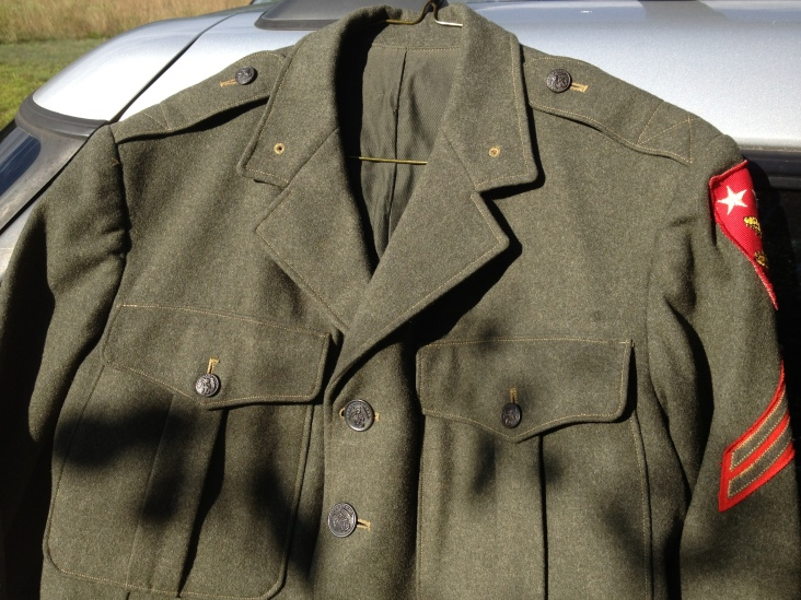 The front of the blouse would have featured two Eagle, Globe, and Anchor pins (in the two holes on the collar) as well as Asack's ribbons (Purple Heart, American Campaign, Asia-Pacific Campain with two stars, WWII Victory) and any weapons qualification badges.