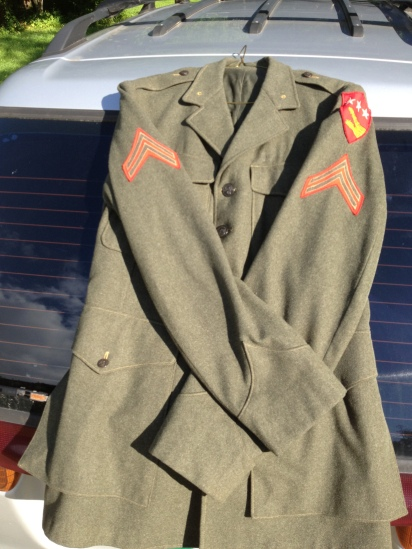 Corporal Asack owned this blouse near the end of his time in the service, as evidenced by the unusual insignia on the left sleeve.