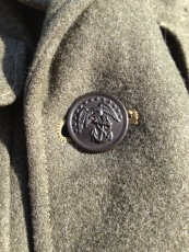 Each of the buttons features and eagle with fouled anchor.