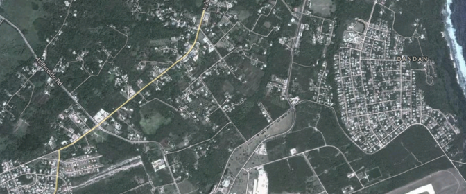 """The area today, as seen on Google Maps. 1/24 began near the """"As Perdido Road"""" text, then crossed the flat ground heading towards Dandan. The cane fields have been replaced with houses; the ridge they occupied that night is on the very outskirts of modern Dandan."""