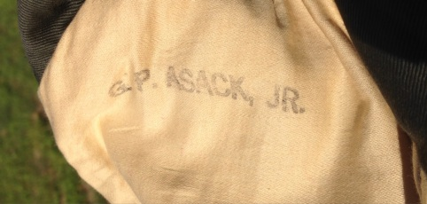 However, this definitely belonged to the Baker Company NCO - there was only one G. P. Asack, Jr. serving in the Corps. All Marines were expected to have their clothing stamped in accordance with regulations, and Asack followed them - this would appear inside the right sleeve.