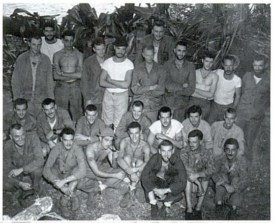 Raider officers at Enogai. Banks is standing in the conspicuous white t-shirt; to his left is Colonel Griffith.