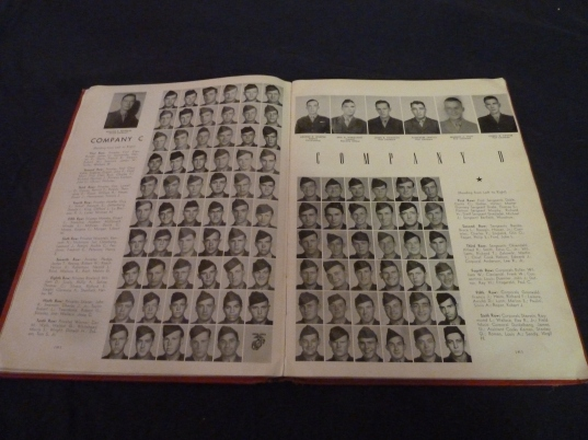 Much of the Red Book is dedicated to yearbook-style photos. These pages feature Companies C and D.
