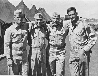 """Dick and Gunnies."" Lyon (right) with three unidentified Marines, possibly battalion gunnery sergeants."