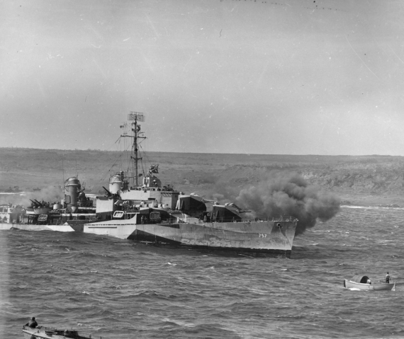 USS Putnam bombarding Iwo Jima. Stott would land on the beach to the destroyer's left; his battalion would fight on the high ground to its right.