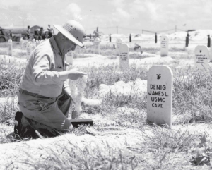 Brigadier General Robert Denig visits his son's grave on Namur. PFC Carmen Ramputi (D/1/24) is buried at top right.