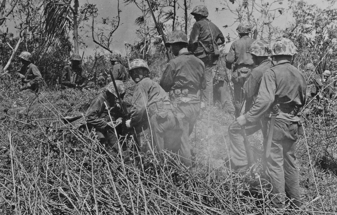Namur, 2 February. Bayonets fixed, a rifle squad gets ready to move out into the underbrush. Official USMC photo by Sgt. Andrew Zurick.