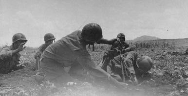 This mortar team has painted their helmets. June, 1944.
