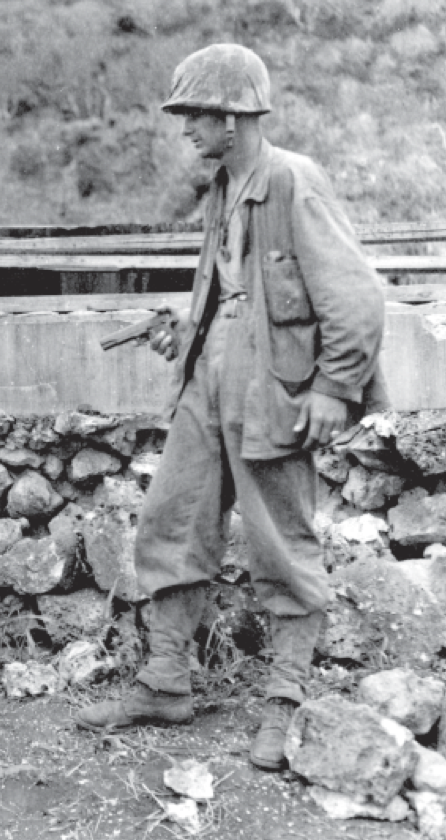 Near the end of the battle, a Marine with an M1911 pistol searches for Japanese stragglers.