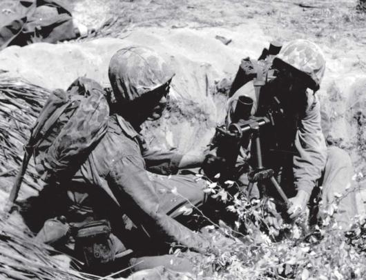 A gunner and assistant gunner of a 60mm mortar team.