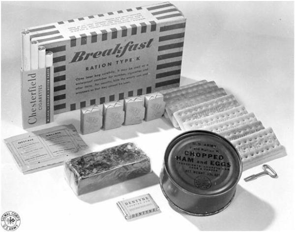 Breakfast: canned chopped ham and eggs; biscuits; Dextrose or Malted milk tablets; dried fruit bar or oatmeal; Halazone water purification tablets; a four-pack of cigarettes; Dentyne or Wrigley chewing gum; instant coffee; sugar.