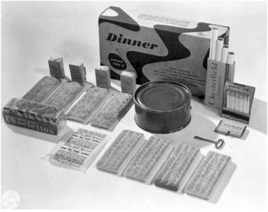 Lunch: canned entree Pork luncheon meat or processed American cheese, Swiss and American cheese, or Bacon and cheese; biscuits; 15 malted milk tablets or five caramels; sugar; salt packet; a four-pack of cigarettes and a box of matches; chewing gum; powdered beverage packet (in 1944, lemon or orange flavor; grape introduced 1945).
