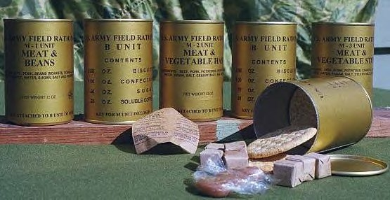 A selection of C-rations. Two tins (one M-Unit and one B-Unit) made up one meal. Monotony and quality were constant complaints; the Meat and Vegetable Hash achieved legendary status as the least favorite meal of Allied troops in the war.