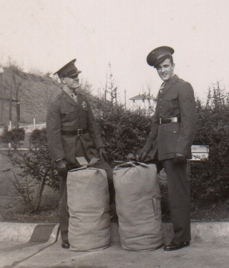 PFC Frank Schnell (left) and John Waytow with seabags packed, December 8, 1942. The two communications specialists were on their way to their new post with the First Separate Battalion.