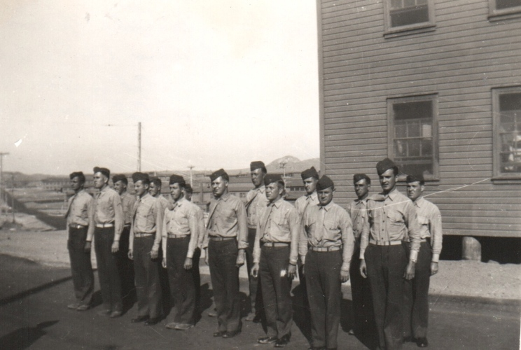 """A Sunday evening chow formation. August 22, 1943, Camp Pendleton, Calif. (Front - L to R) PFC John J. Murach, PFC Wm. Bigleman, PFC H. W. Van Steenis, PFC Joe Teliha, PFC J. L. ""Moon"" McMullen, Cpl. Walter H. Prall, Cpl. Donald A. Christiansen, Cpl. John Waytow. (Rear - L to R) PFC R. J. ""Joe"" Kelly, PFC Frank Schnell, PFC J. J. Priest, [?], PFC Dale E. ""Duke"" Wellington, PFC K. W. Jones, PFC Abe Lehrman, PFC Vernon Lewis."""