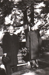 At Waytow's grave. The officiating minister and an unknown Marine, possibly a friend of Waytow's or a member of an honor guard or escort.