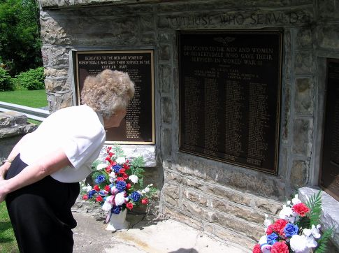John Waytow's youngest sister, Helen Hicks, visits a memorial in Robertsdale, PA.