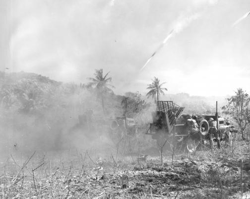 Marine jeeps and trucks unleash rockets against the Japanese on Saipan.