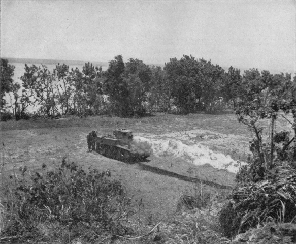 A more fortunate Satan tank attacks a Japanese hideout. Note Marines behind the tank directing fire. USMC photo.