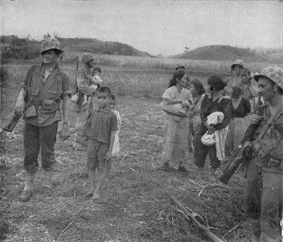 Marines with civilian prisoners. Official USMC photo.