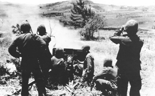 A 75mm gun from the 14th Marines fires in support of infantry. National Archives photo.