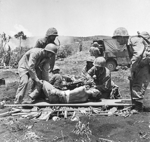 Marines prepare to load a wounded Marine into an ambulance. Their identities are unknown, but the scene involving Williams would have been similar.