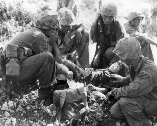 Marines and corpsmen treat an ailing child.