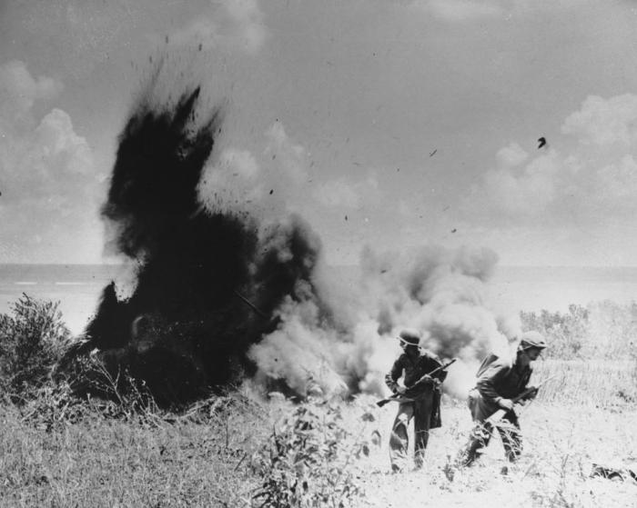 A demolitions team in action on Saipan.